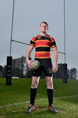 Rugby player stands on pitch