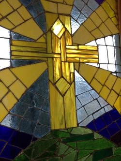 stained glass window of a cross from Sexey's Sanctuary