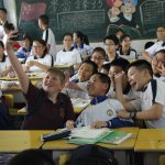 Student takes selfie in Chinese classroom