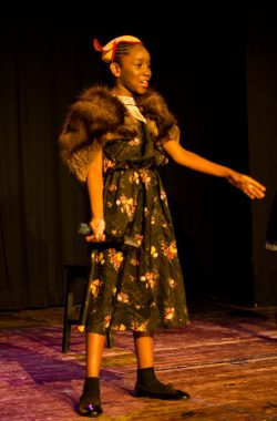 A female student sings during Bugsy Malone