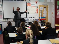 Author Charlie Higson teaches English class