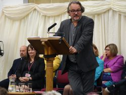 charlie higson addresses audience at speech day