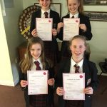 Female students with certificates from GCHQ competition