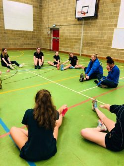 Stretches during Team Bath netball masterclass