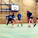 Sexey's students play netball game with Bath Netball players coaching