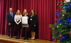 Sixth Formers and Senior Leaders pose with ALPS certificate