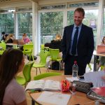 Head of Sixth Form talks to student