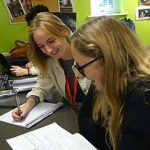 Sixth Form student works with teacher on UCAS