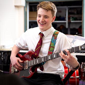 Student plays guitar