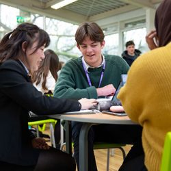 Sixth Form students work around table together