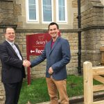 Ross Dalzell (Sexey's) shaking hands with Simon Westgate (Wessex Outreach)