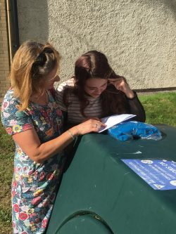 Female student celebrates with mother at GCSE results day
