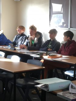 Politics students engaged in discussion about US Elections