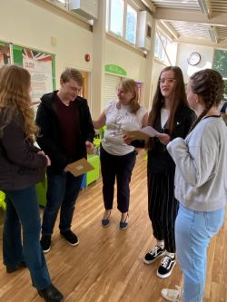 Headteacher with A Level students collecting results