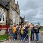 Sexey's School students celebrate GCSE results in front of school building
